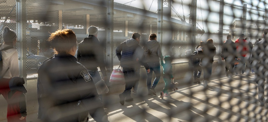 Migrants are processed by CBP at the San Ysidro Port of Entry in 2018.