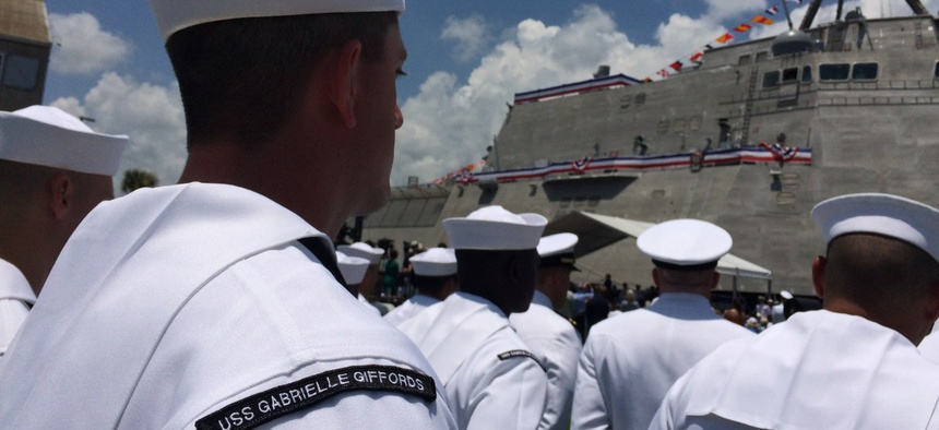 USS Gabrielle Giffords (LCS 10) Sailors stand in formation during a commissioning ceremony held in the Port of Galveston in 2017.