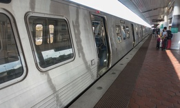 A train leaves National Airport metro station. Outdoor stations south of the airport stop are closed for the summer.