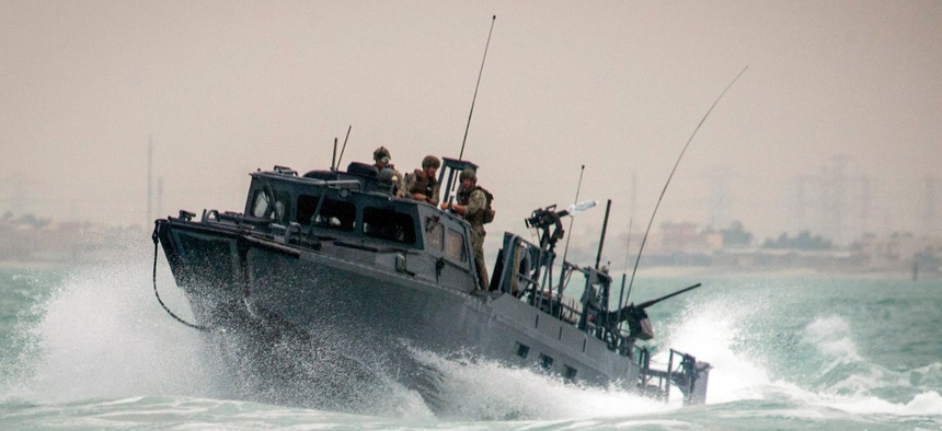A riverine command boat navigates rough seas during patrol operations in the Persian Gulf on Oct. 30, 2015. Iran was holding 10 U.S. Navy sailors and their two boats, similar to the one pictured here, on Farsi Island on Jan. 12, 2016.
