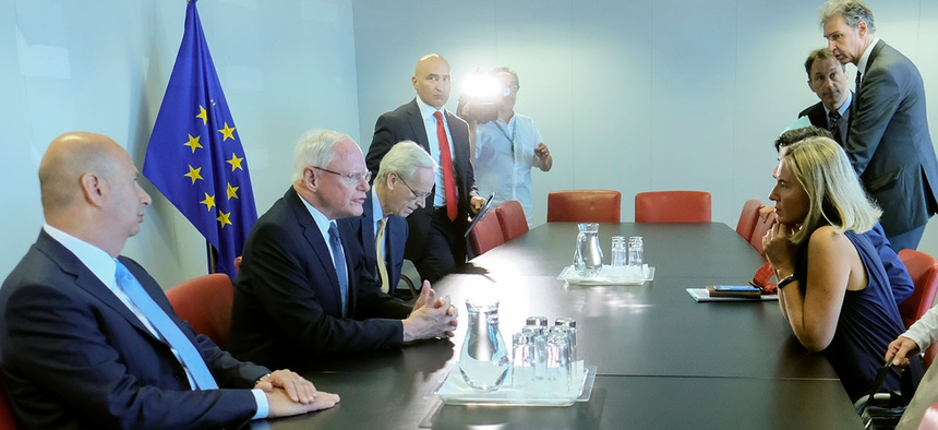Special Representative for Syria and for the Coalition to Defeat Islamic State militants Jim Jeffrey, second left, meets with EU foreign policy chief Federica Mogherini at EEAS headquarters in Brussels on Friday.
