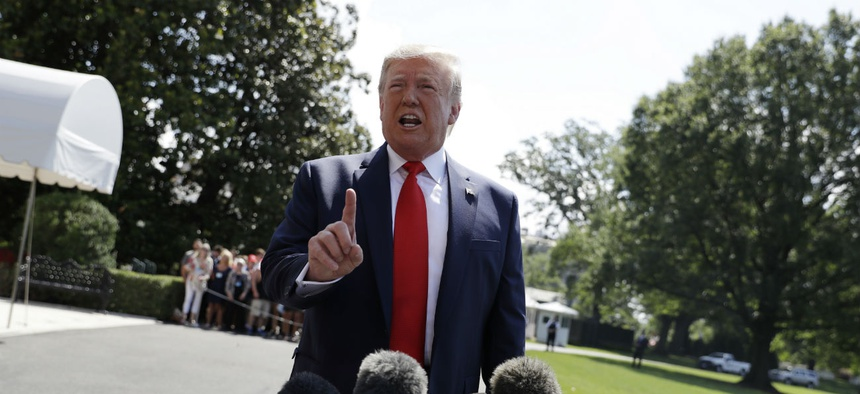 President Donald Trump talks to reporters on the South Lawn of the White House before departing for his Bedminster, N.J. golf club on Friday, July 5.