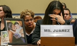 Yazmin Juárez reacts as a photos of her daughter, Mariee, who died after being released from detention by U.S. Immigration and Customs Enforcement, is placed next to her at a House Oversight subcommittee hearing on Wednesday.