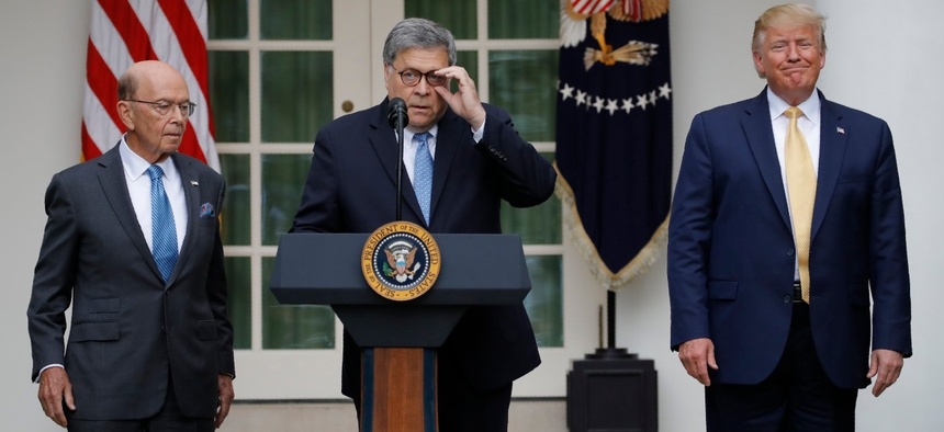 Attorney General William Barr speaks as President Donald Trump and Commerce Secretary Wilbur Ross listen as he speak about the census in the Rose Garden at the White House in July.