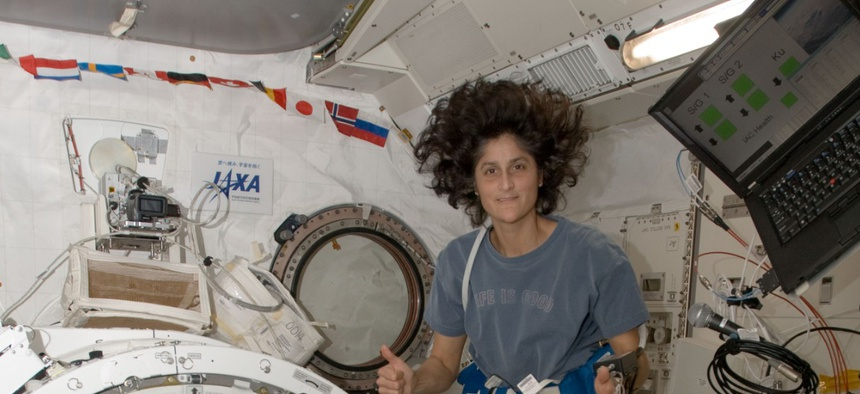 American Astronaut Sunita Williams from Expedition 33 floats next to the J-SSOD containing TechEdSat-1 in 2015.