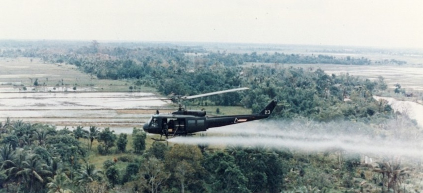 A .S. Huey helicopter sprays Agent Orange over Vietnam.