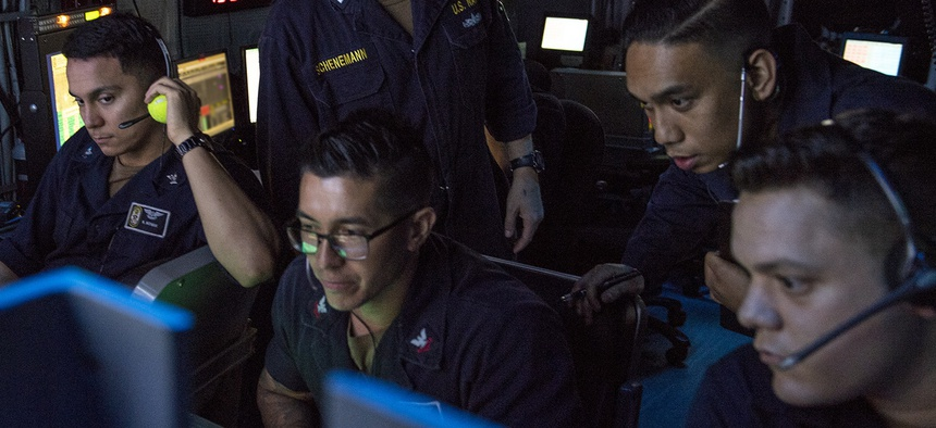 GULF OF ADEN (July 2, 2019) Sailors assigned to amphibious assault ship USS Boxer (LHD 4) observe flight operations on the display of an OD-220 radar from inside the amphibious air traffic control center.