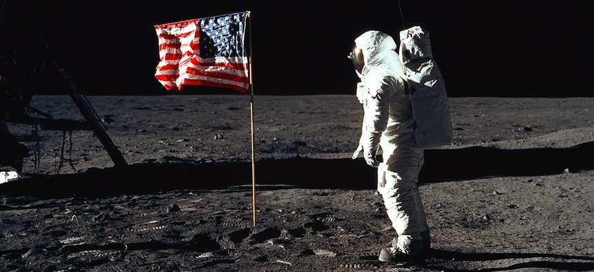 Government Hall of Fame inductee Buzz Aldrin salutes the American flag on the surface of the moon in July 1969.