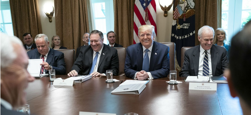 President Trump speaks with reporters during a Cabinet meeting on July 16. Of the record number of vacancies, the president has said he likes to have acting officials as a way of bypassing the confirmation process.