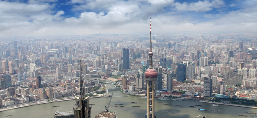 A planned shift in the TSP's international fund investments to include sanctioned Chinese companies has riled Senators. Above, an aerial view of Shanghai.