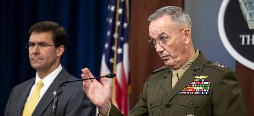 Joint Chiefs Chairman Gen. Joseph Dunford with Secretary of Defense Mark Esper speaks to reporters during a briefing at the Pentagon on Wednesday.