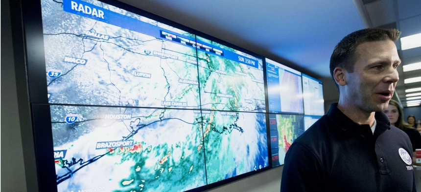 Acting Homeland Security Secretary Kevin McAleenan visits the National Response Coordination Center at FEMA headquarters in Washington in July.