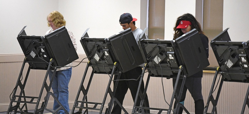 People us voting machines in St. Louis in 2016.