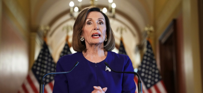 House Speaker Nancy Pelosi of Calif., reads a statement announcing a formal impeachment inquiry into President Donald Trump on Tuesday.