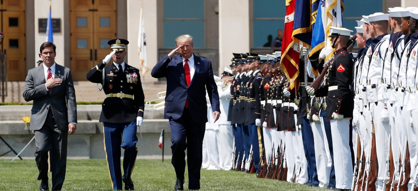 President Donald Trump, right, and Secretary of Defense Mark Esper, left, salute the flags, during a full honors welcoming ceremony for Esper at the Pentagon on July 25.