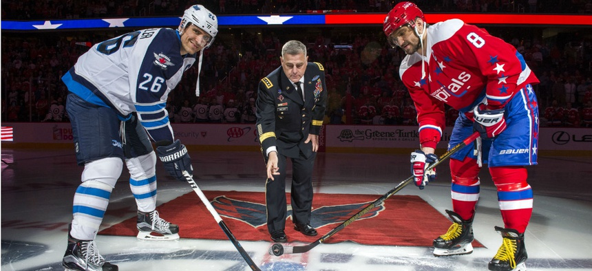 Army Chief of Staff Gen. Mark A. Milley drops the ceremonial puck at the beginning of a hockey game between the Washington Capitals and Winnipeg Jets in Washington in November 2016.