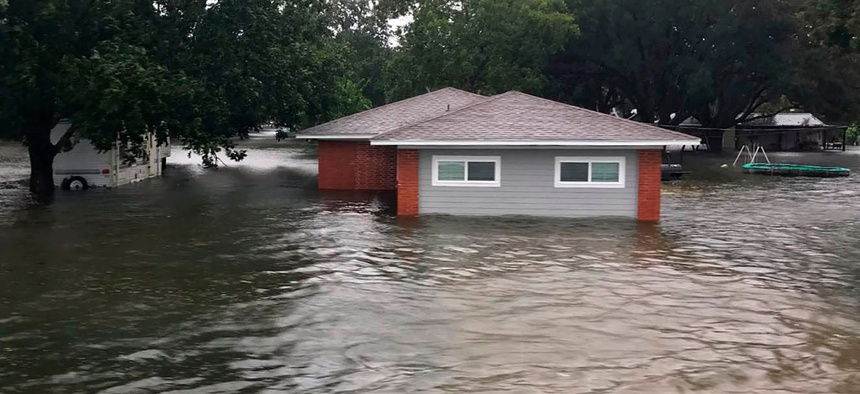 Floodwaters surround a home on Sept 19, 2019, in Winnie, Texas.