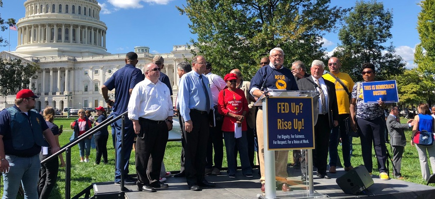 """Any attempts by agencies to enforce these provisions outside of the collective bargaining process will be met with immediate legal challenge by the union,"" warned J. David Cox, AFGE's president. Cox, above, speaks at a union rally in late September."