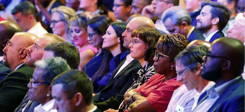 Voters listen during a debate between Democratic candidates for president in Miami on June 26.