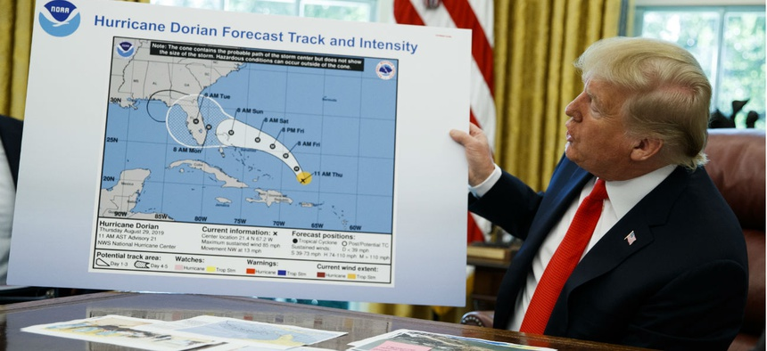 President Trump holds up a chart of Hurricane Dorian's projected path during a briefing on Sept. 4.