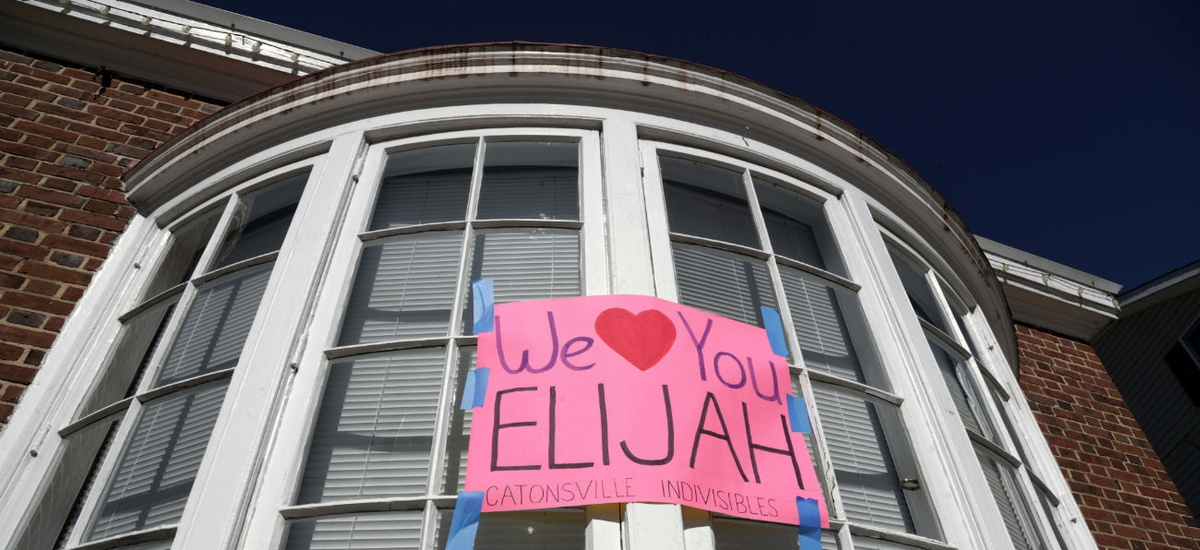 Messages are seen outside of the office of the late Rep. Elijah Cummings, D-Md., in Catonsville, Md., on Saturday.