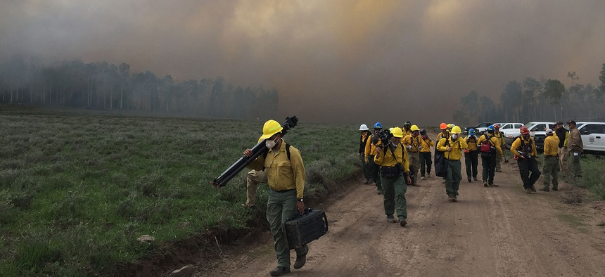 Researchers moving to get out of the heavy smoke.