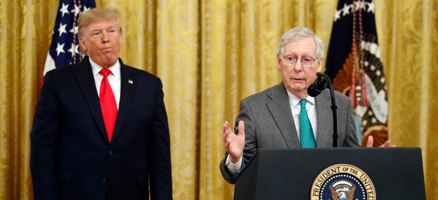 President Donald Trump listens as Senate Majority Leader Mitch McConnell of Ky., speaks in the East Room of the White House during an event about Trump's judicial appointments, Wednesday, Nov. 6, 2019, in Washington.