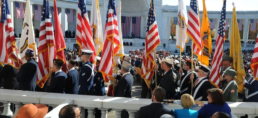 Veterans gather at Arlington Cemetery in 2014 to mark Veterans Day.