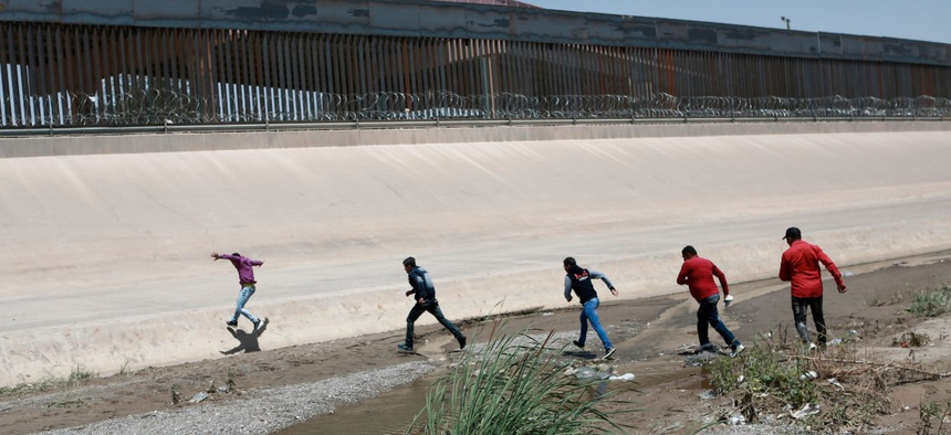 Migrants cross the Rio Bravo in June.