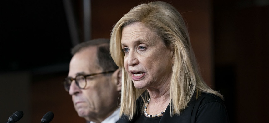 Rep. Carolyn Maloney, chair of the House Committee on Oversight and Reform, joined at left by Rep. Jerrold Nadler, chairman of the House Judiciary Committee, discusses the impeachment investigation on Oct. 31.