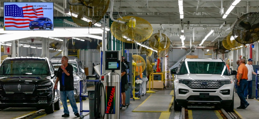Ford's employees work on a Lincoln Aviator and Ford Explorer lines at Ford's Chicago Assembly Plant in June.