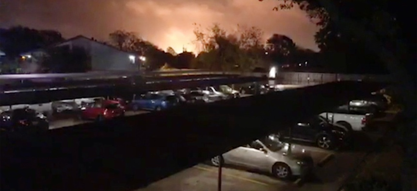 Smoke and fire fill the sky from a massive explosion at a Texas chemical plant on Nov. 27, in Port Neches, Texas.