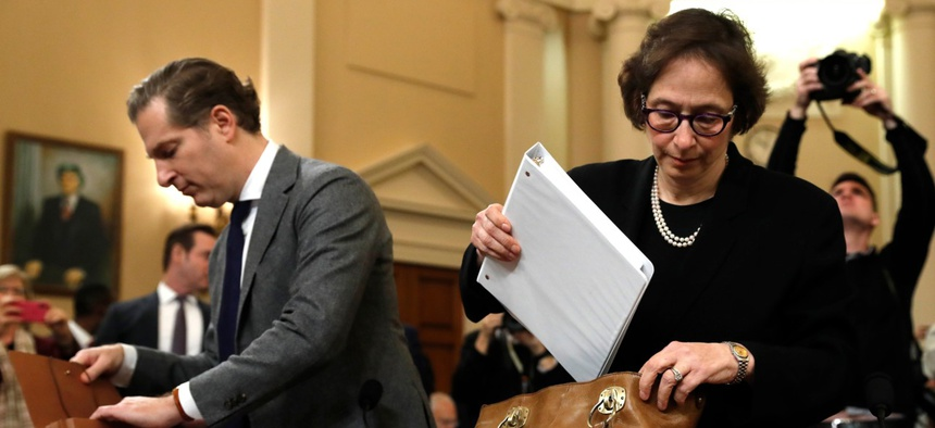 Constitutional law experts, from left, Harvard Law School professor Noah Feldman and Stanford Law School professor Pamela Karlan, arrive to testify during a hearing Wednesday.