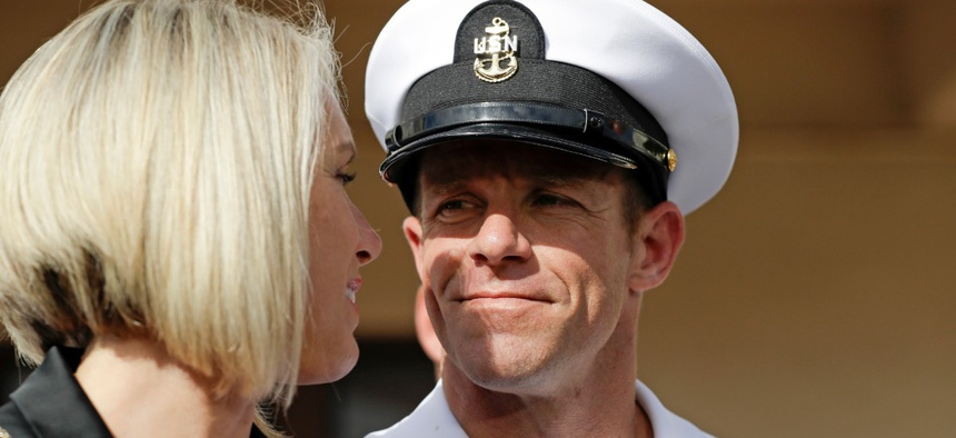 The former Navy SEAL Edward Gallagher, right, Aug. 1, 2019