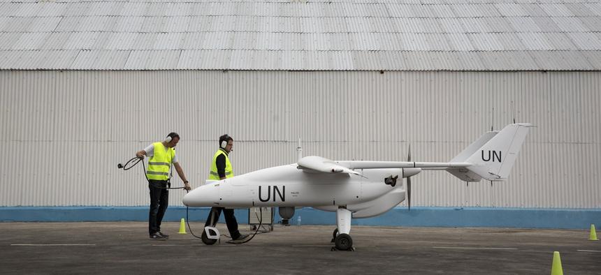 U.N. technicians prepare an unarmed drone for flight over the Democratic Republic of Congo.