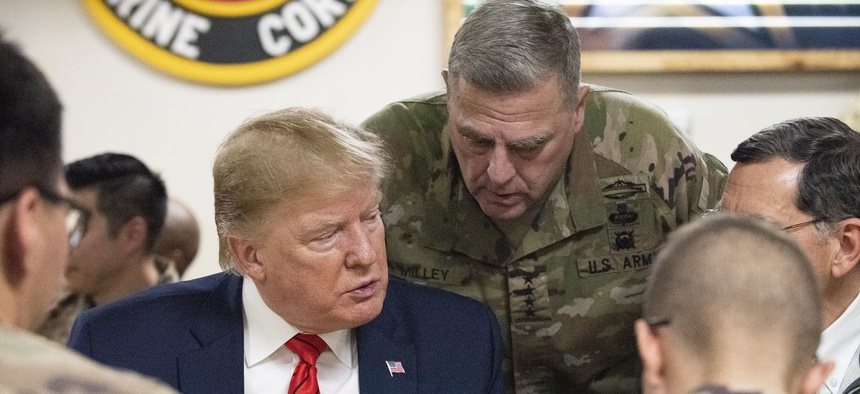 President Donald Trump and Gen. Mark Milley, chairman of the Joint Chiefs of Staff, meet with service members at Bagram Airfield in Afghanistan, Nov. 28, 2019.