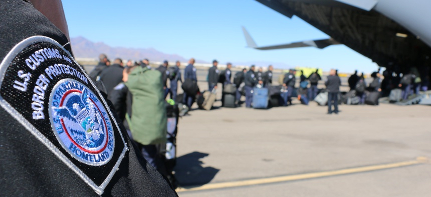 U.S. Customs and Border Protection officers from the El Paso Field Office board a U.S. Air Force C-17 aircraft at El Paso International Airport for transport to California in support of CBP's Operation Secure Line in 2018.