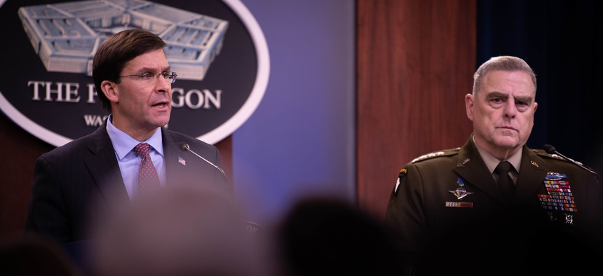 Defense Secretary Mark T. Esper and Chairman of the Joint Chiefs of Staff Army Gen. Mark A. Milley briefs the media at the Pentagon in December.