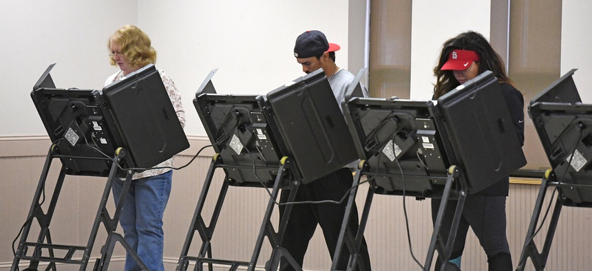 Voters are shown at a polling place in St. Louis in 2016.