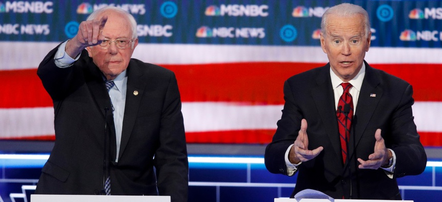 Sen. Bernie Sanders, I-Vt., left, during Wednesday's presidential primary debate defended his failure to fully release his medical records. Former Vice President Joe Biden, right,  said transparency is important but has also faced questions on the issue.