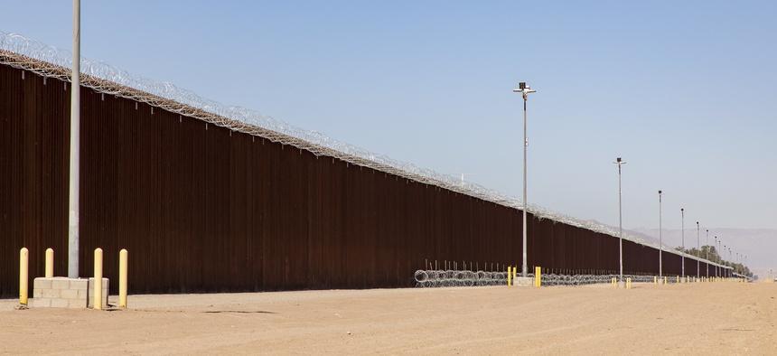 The border wall is shown near Calexico, California.