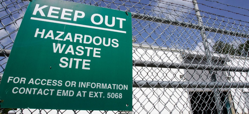 A sign is posted at an ongoing cleanup pump and treatment center operated by Shaw Corp. on lot 203 at Camp Lejeune, N.C., in 2007.