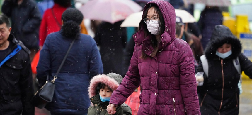 Shoppers in New York City wear masks to protect from the novel coronavirus.