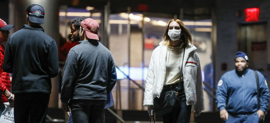 A commuter wears a face mask in the New York City transit system, Monday, March 9, 2020, in New York.