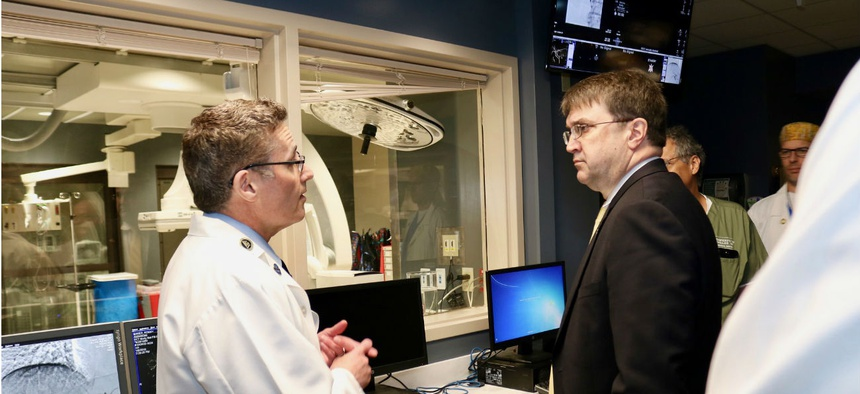 VA Secretary Robert Wilkie, above right, tours the Minneapolis VA Health Care System in August 2018.