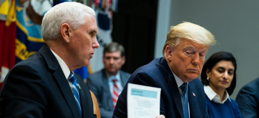 President Donald Trump and Centers for Medicare and Medicaid Services Seema Vermalisten as Vice President Mike Pence speaks during a meeting on the Coronavirus with health care company leaders on Tuesday
