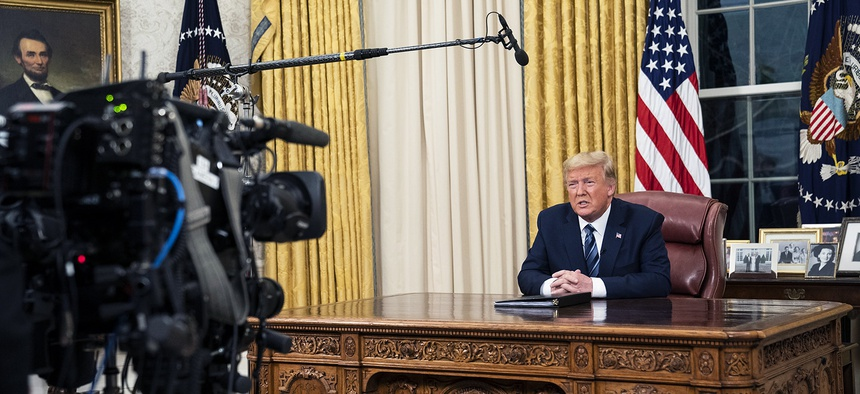 President Donald J. Trump addresses the nation from the Oval Office of the White House Wednesday evening.