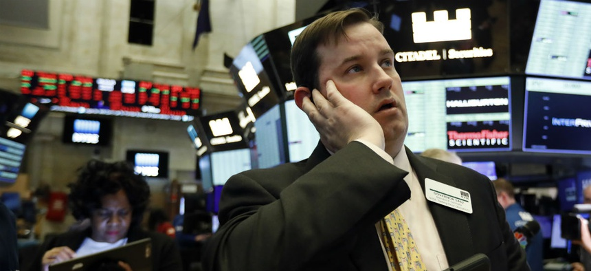 Brian Connolly, with NYSE Trading Floor Operations, works on the floor of the New York Stock Exchange during the trading halt, Thursday, March 12, 2020.