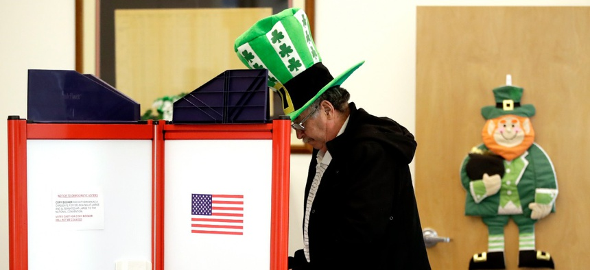 A voter fills out his ballot, taking advantage of early voting on Sunday in Steubenville, Ohio.