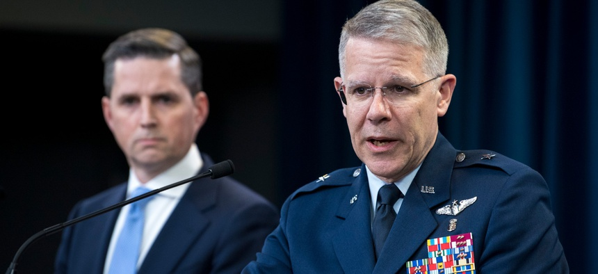 Assistant to the Secretary of Defense for Public Affairs Jonathan Rath Hoffman listens as  Joint Staff Surgeon Air Force Brig. Gen. (Dr.) Paul Friedrichs briefs the media about the Defense Department's response to COVID-19 on Monday.